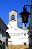 Bell tower on the surrounding wall around Faro old town Royalty Free Stock Images