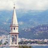 The bell tower of Sveti Ivan St.John Catholic Church Cathedral. View from top of citadel old town of Budva in Montenegro royalty free stock images