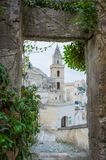 Bell tower view from the arch of leaves. Walking through the historic center of matera I struggled in this view Royalty Free Stock Image
