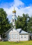 Bell tower in Vologda and traditional russian wooden house. Russia Stock Images