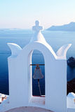 Bell tower of white church above the beautiful blue sea, Oia, Sa Royalty Free Stock Photos