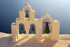 Bell tower of white church, Oia, Santorini, Greece Royalty Free Stock Image