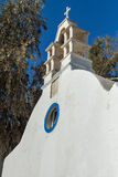 Bell tower of White orthodox church in Mykonos, Cyclades, Greece Royalty Free Stock Photos