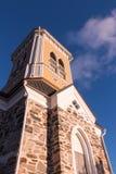 Bell tower of a wooden Lutheran church Stock Photos