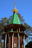 Bell tower of wooden Russian Orthodox Christian Church of Holy Royal Martyrs in Ganina Yama Monastery. Bell tower of wooden Russian Orthodox Christian Church of Royalty Free Stock Photos