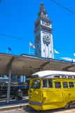 The bell tower and the yellow tram in San Francisco Royalty Free Stock Image