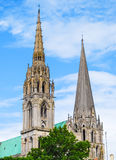 Bell towers of Chatres cathedral, France. Bell towers of the famous cathedral in Chartres, France Stock Image
