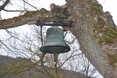 Bell on a tree. Photography of old bell hanging on a tree branch, for notification in the villages, old Serbian religion royalty free stock photos