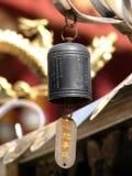Bell u. Drache Stockbild