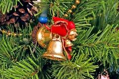 Bell und Bogen-Weihnachtsbaum-Verzierungen Lizenzfreies Stockbild