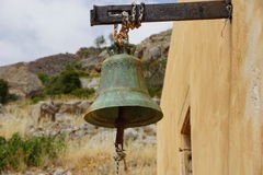 The bell on the wall in the Spinalonga island, Greece. Royalty Free Stock Photo