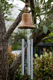 Bell wind chimes. Wind chimes in bell shape hang on tree for garden decoration Stock Images