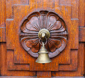 A bell on wooden door at Old Town in Penang, Malaysia Royalty Free Stock Photography