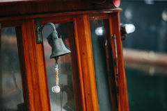 Bell on wooden ship Stock Images