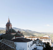 Bell of Zahara. Aerial view of the Spanish city of Zahara de la Sierra, churches and domed roofs with white house Stock Images