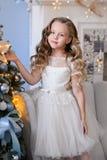 Bella bambina in un vestito stupefacente Immagini Stock
