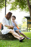 Bella donna asiatica con vostro figlio Fotografia Stock