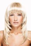 Bella donna bionda con capelli brillanti lunghi Immagini Stock Libere da Diritti