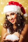 Bella donna in cappello del Babbo Natale Fotografia Stock