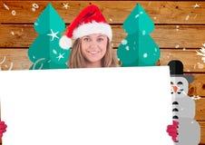Bella donna in cappello di Santa che tiene cartello bianco 3D Fotografia Stock