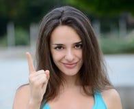 Bella donna che fa il segno d'avvertimento della mano Fotografia Stock