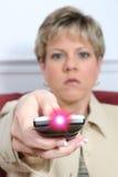 Bella donna che mira periferico con indicatore luminoso sopra Fotografia Stock