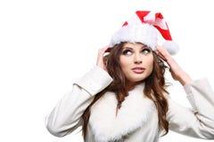 Bella donna che propone come Babbo Natale. Isolato. fotografia stock libera da diritti