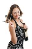 Bella donna che propone con una bottiglia Immagini Stock Libere da Diritti