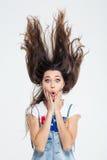Bella donna con capelli su nell'aria fotografia stock libera da diritti