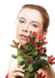 Bella donna con i fiori rossi Immagine Stock