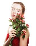 Bella donna con i fiori rossi Immagini Stock Libere da Diritti