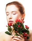 Bella donna con i fiori rossi Immagine Stock Libera da Diritti