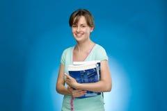 Bella donna con i libri Immagini Stock