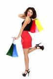 Bella donna con i sacchetti di acquisto variopinti Immagini Stock Libere da Diritti