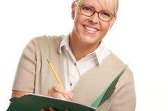 Bella donna con la matita ed il dispositivo di piegatura Immagini Stock Libere da Diritti