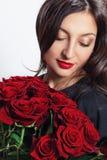 Bella donna con le rose Immagini Stock