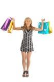 Bella donna con molte borse di acquisto. isolato su bianco Immagini Stock Libere da Diritti