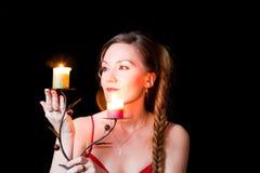 Bella donna con una candela a natale Fotografia Stock Libera da Diritti
