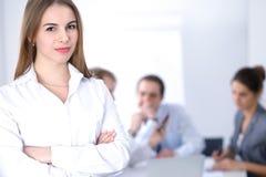 Bella donna di affari alla riunione Immagine Stock