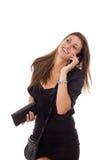 Bella donna di affari che parla sul sorridere del telefono fotografia stock