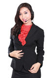 Bella donna di affari con la cuffia avricolare Fotografie Stock