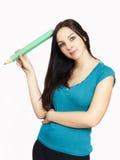Bella donna di affari con la grande matita Fotografia Stock