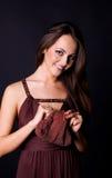 Bella donna di fascino con la borsa Fotografia Stock