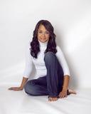 Bella donna etnica su priorità bassa bianca Fotografia Stock