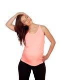 Bella donna incinta che fa allungamento Fotografia Stock Libera da Diritti