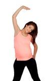 Bella donna incinta che fa allungamento Immagine Stock Libera da Diritti