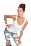 Bella donna in jeans strappati alla moda Fotografia Stock