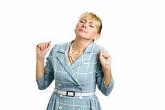 Bella donna matura d'allungamento su bianco Fotografie Stock Libere da Diritti