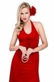 Bella donna nei dres rossi Fotografia Stock