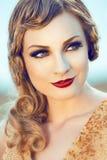 Bella donna in oro Fotografie Stock Libere da Diritti